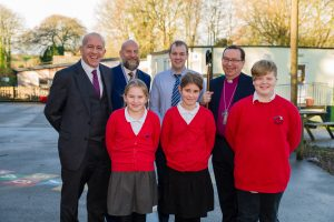 Bishop Philip is photographed with pupils and staff from the school.