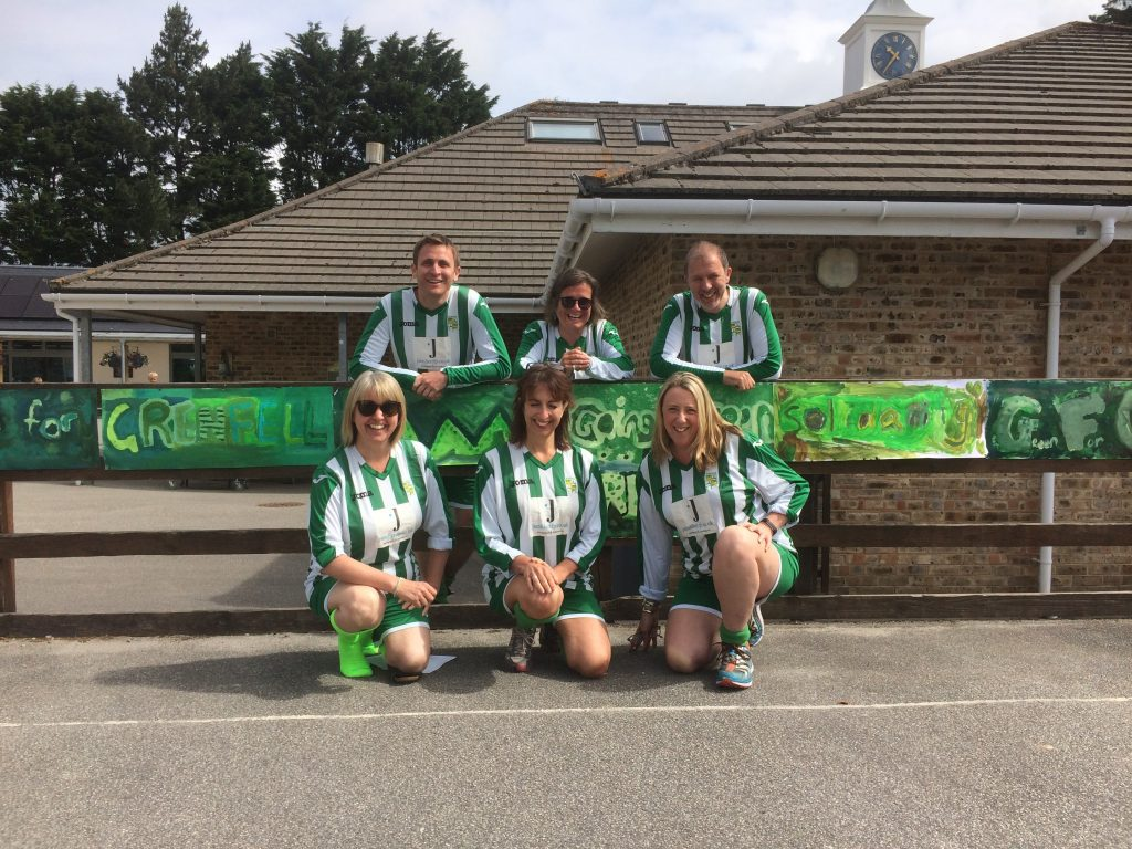 A photograph of teachers dressed in green football strips to Go Green for Grenfell.