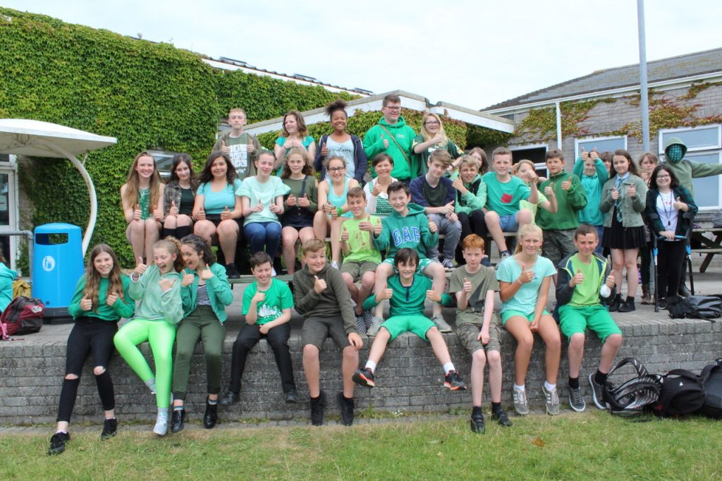 Mullion School pupils dressed in green to mark the first anniversary of the fire at Grenfell Tower.