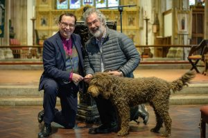 Bishop Philip with a safeguarding trainer and a dog